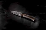 Damascus steel knife on slate