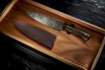 Damascus steel knife in presentation box on slate