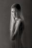 fine art black and white studio sexy female nude with draped veil