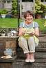 GRA_9792-woman-having-a-cup-of-tea-and-biscuit-outside