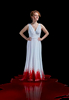 woman in a long white dress with blood on it while standing in a pool of blood