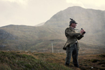 Gamekeeper in a deerstalker out in the rain on the Clisham mountain