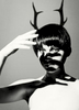 nude female model as mythical god cerynitis with the shadow of antlers of a deer