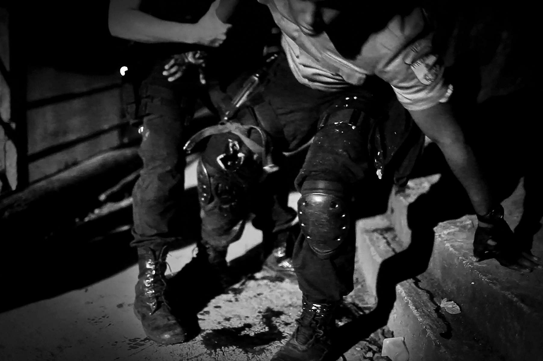 A UPP Military Policemen officer had been shot by gangs while on patrol in Sao Carlos, Rio de Janeiro, Brazil, May 5, 2012. Initiated in 2008, the UPP, short for Unidade de Polícia Pacificadora (in English, Pacifier Police Unit or Police Pacification Unit), is a new system of community policing in Rio de Janeiro's favelas once run by drug traffickers. While many believe that UPPs have helped quell violence by opening the doors of the favelas to public services such as legal electricity supply, garbage collection, education, public works and social assistance program, others see the pacification program as a temporary cover-up to security problems in Rio de Janeiro.
