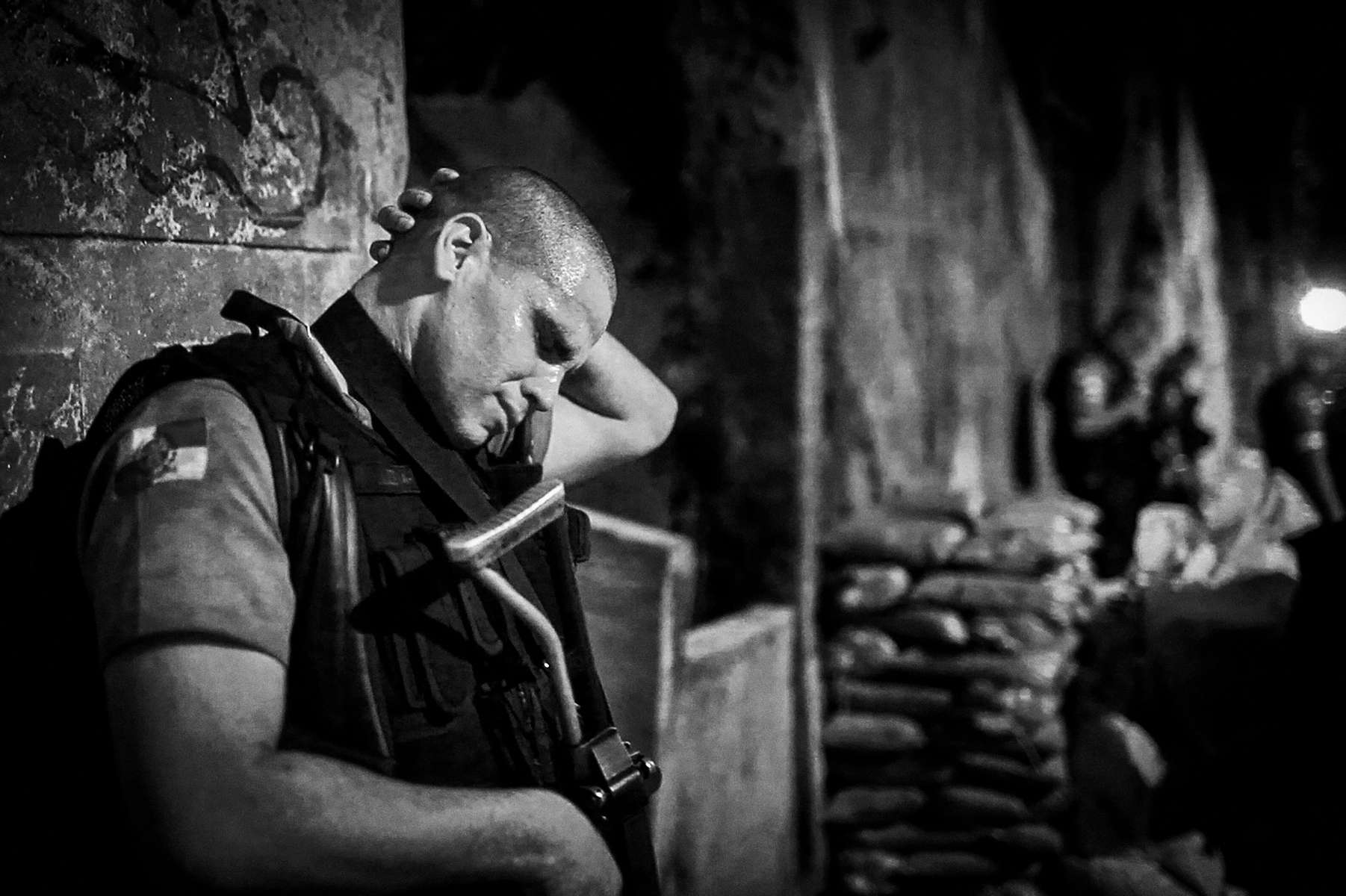 UPP soldier Private Vidal from the 4º UPP of Sao Carlos, breaks on crying after helping evacuate an officer that had been shot by gangs while on patrol in Sao Carlos, Rio de Janeiro, Brazil, May 5, 2012.