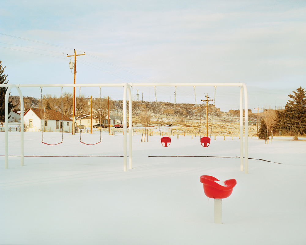 The town playground sits empty after a December snow.