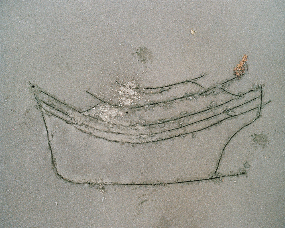 A sketch of a boat used for smuggling, drawn in the sand by Noking.