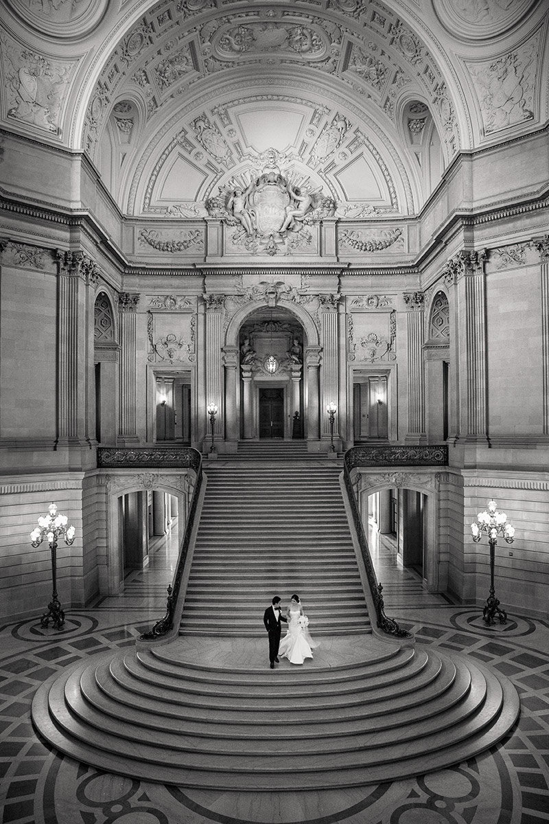 Bride and groom on the stairs of San Francisco City Hall