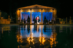 bride and groom by the pool at a grand island mansion wedding