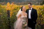 Bride and groom in a vineyard across the Culinary Institute of America, during their wedding there.
