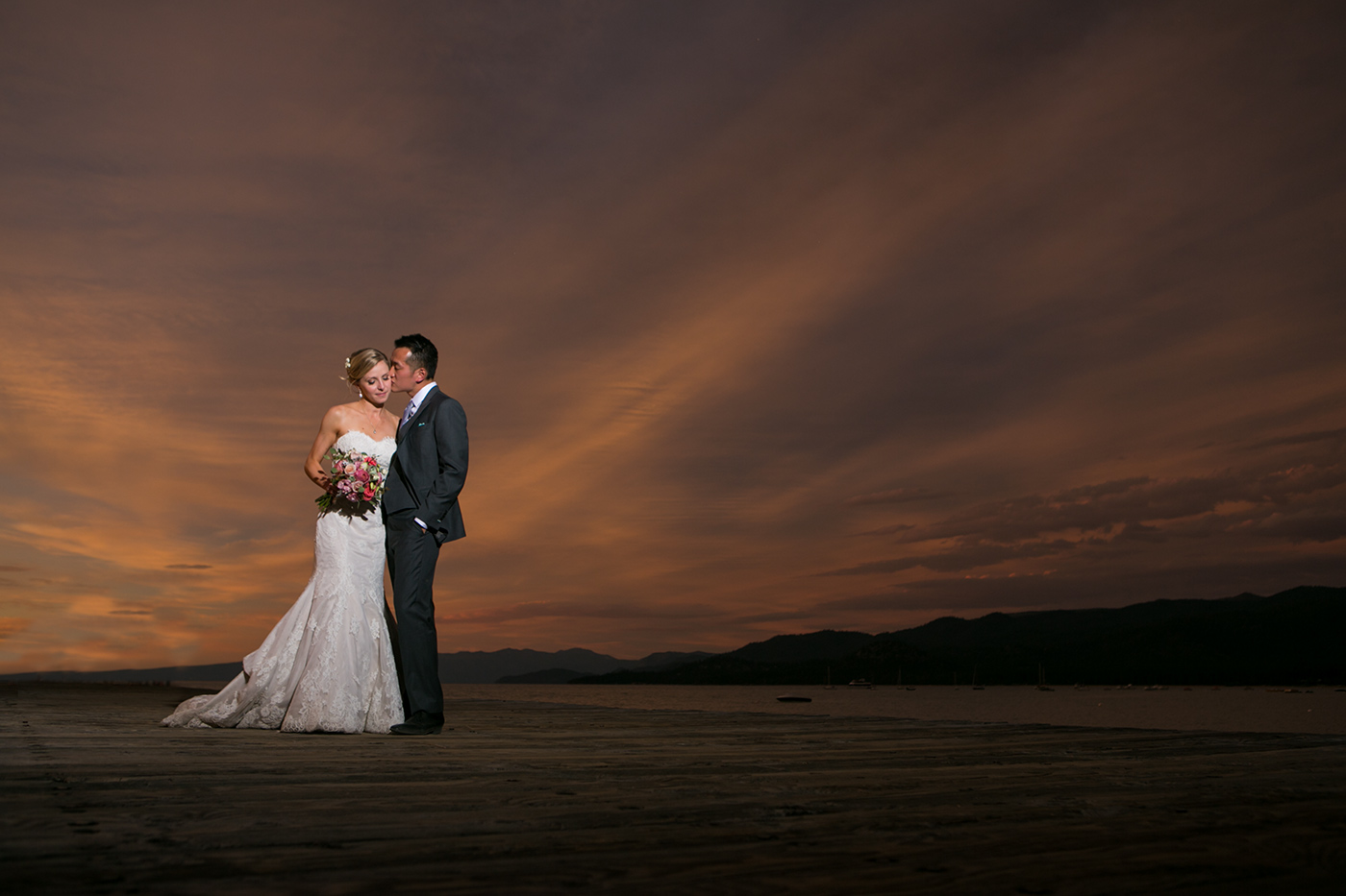 bride and groom walking at the sunset during a hyatt lake tahoe wedding