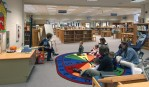 Newton-Lee school library. llibrarian reading to kindergarteners