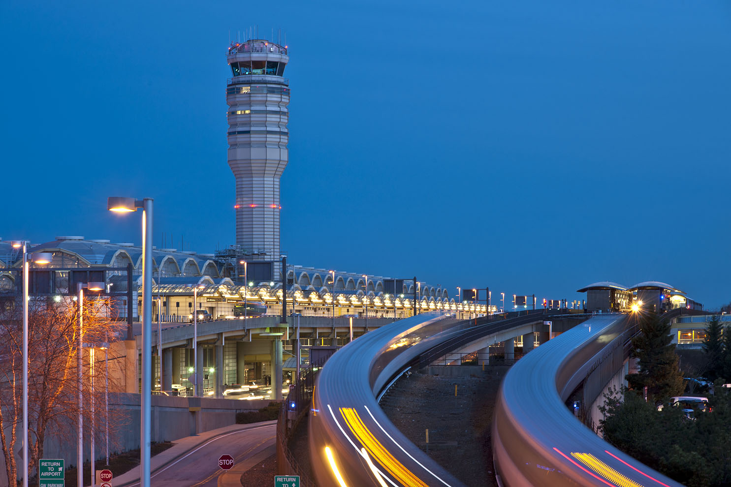 subway trains approaching airport at night