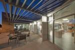 patio with metal trellis overhead