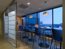 folding glass divider wall, blue table and chairs