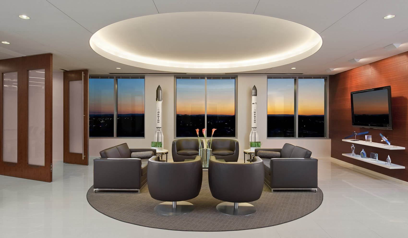 lobby with sunset through windows