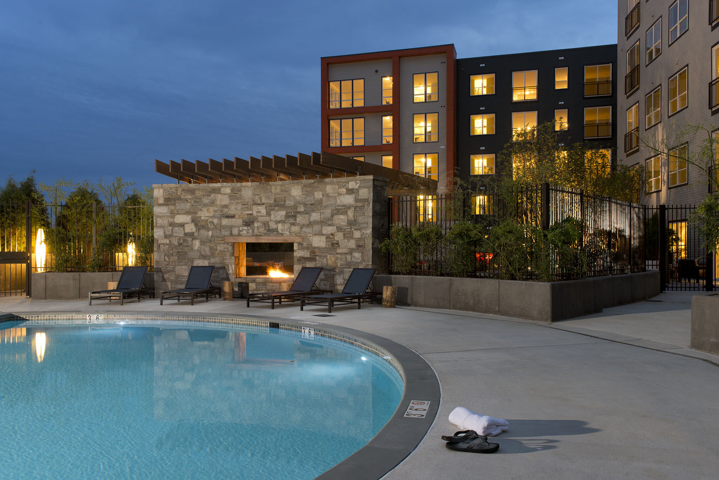 swimming pool, fire place and building at night