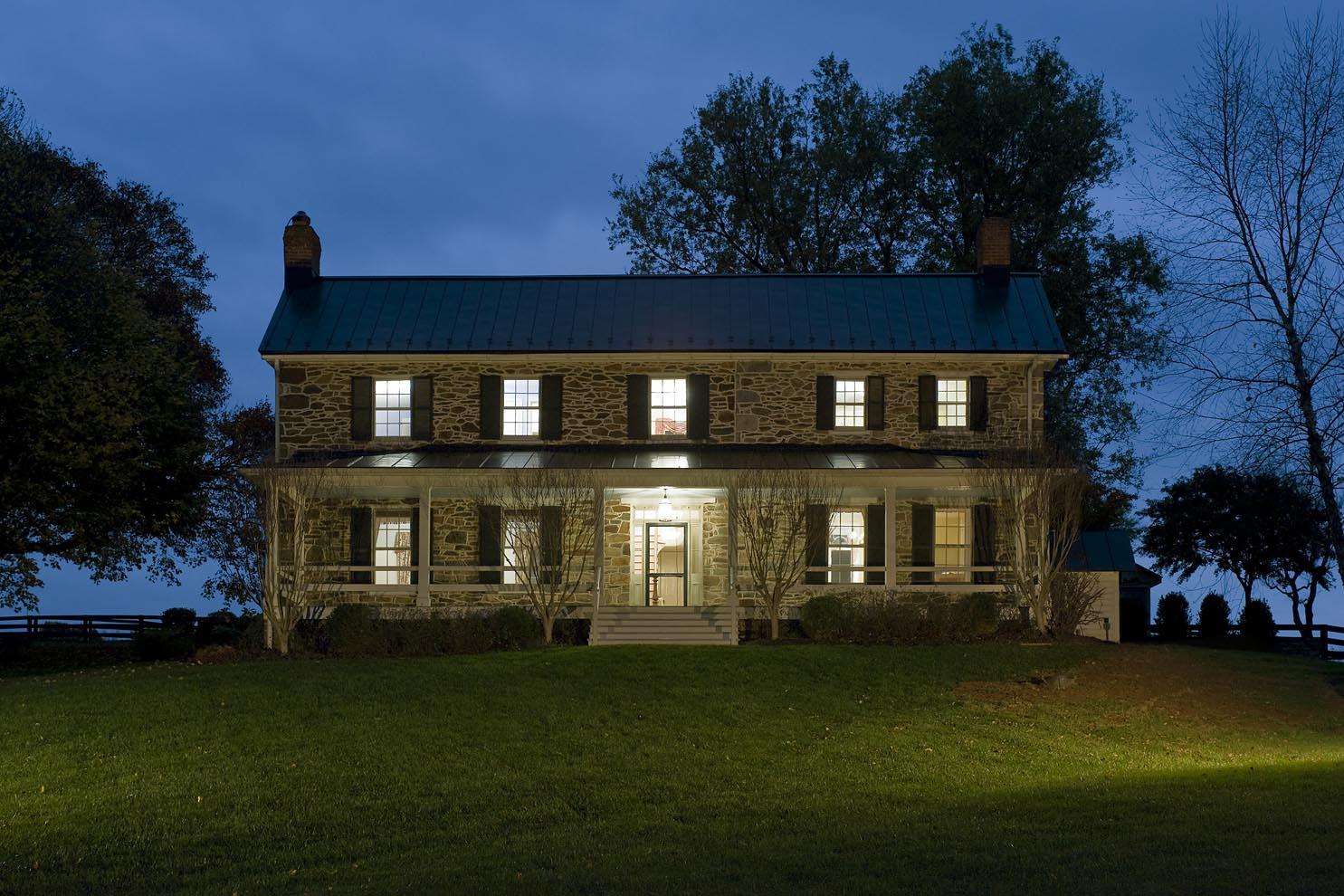 renovated stone manor house at dusk