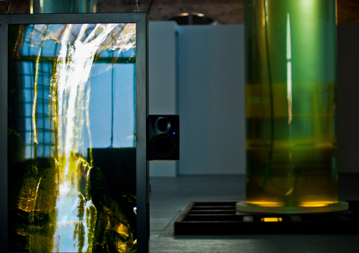 Alexander Ponomarev is represented byFormula.This work consists of two eight-metre high acrylic columns, each clear and hollow with a diameter of one and half metres, containing twelve metric tons of lagoon water.Within each, a kinetic futuro-automobile rises and falls in its vertical casket.