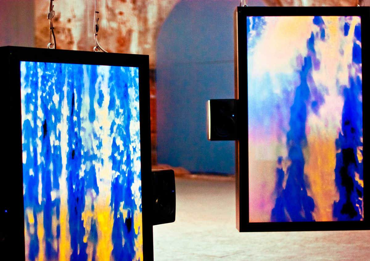 Ryoichi KurokawaOctfalls, a digital audio-visual work that consists of eight LCD screens and attendant speakers suspended from the ceiling of the Arsenale, arranged in an octagonal three-dimensional configuration.Oscillating footage of waterfalls and digital distortion whirls around the viewer with sound producing a hallucinatory effect. It is, in the artist's words,a digital Japanese Garden,a space to contemplate the flow of time.