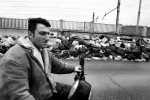 A man rides a motorcycle down a street full of garbage in Caserta, the outskirts of Naples, Italy, on February 21, 2008.