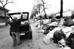 A citizen of Caserta throws garbage onto a big pile near a residential area on February 21, 2008. Locals say the situation was caused by the local mafia Camorra.