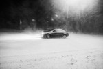 A car makes his way through the blizzard in Ajdovscina, Slovenia, March 10, 2010.