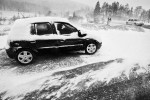 A man tries to start his car in extreme Bora wind and blizzard near Razdrto, Slovenia, on March 10, 2010.