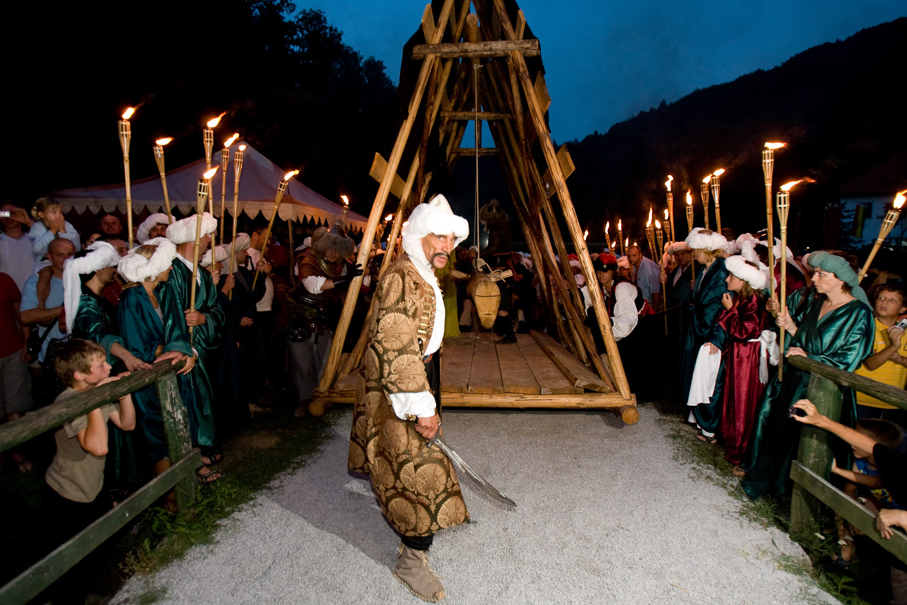 The Ottomans drag a battering ram towards the heavy door of the Zice Carthusian monastery, where the villagers and monks and lay brothers have hidden before. This was the climax of the two-day Fiery Carthusia Medieval event in 2007.