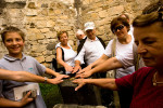 Tourists touch the christening stone in the Church of John the Baptist to feel and fill themselves with energy. The monastery is known for its energy points at various places around the complex, but mostly inside the Church of John the Baptist.