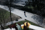 A man returning from grocery shopping walks down an empty street during the coronavirus outbreak nationwide lockdown in Kranj, Slovenia, March 21, 2020.