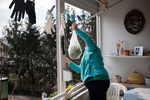 Neighbors send each other vegetables from one balcony to another during the coronavirus outbreak nationwide lockdown in Kranj, Slovenia, on March 21, 2020.