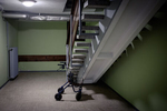 A walker for seniors is parked in the basement of an apartment building during the coronavirus outbreak nationwide lockdown in Kranj, Slovenia, on March 21, 2020.