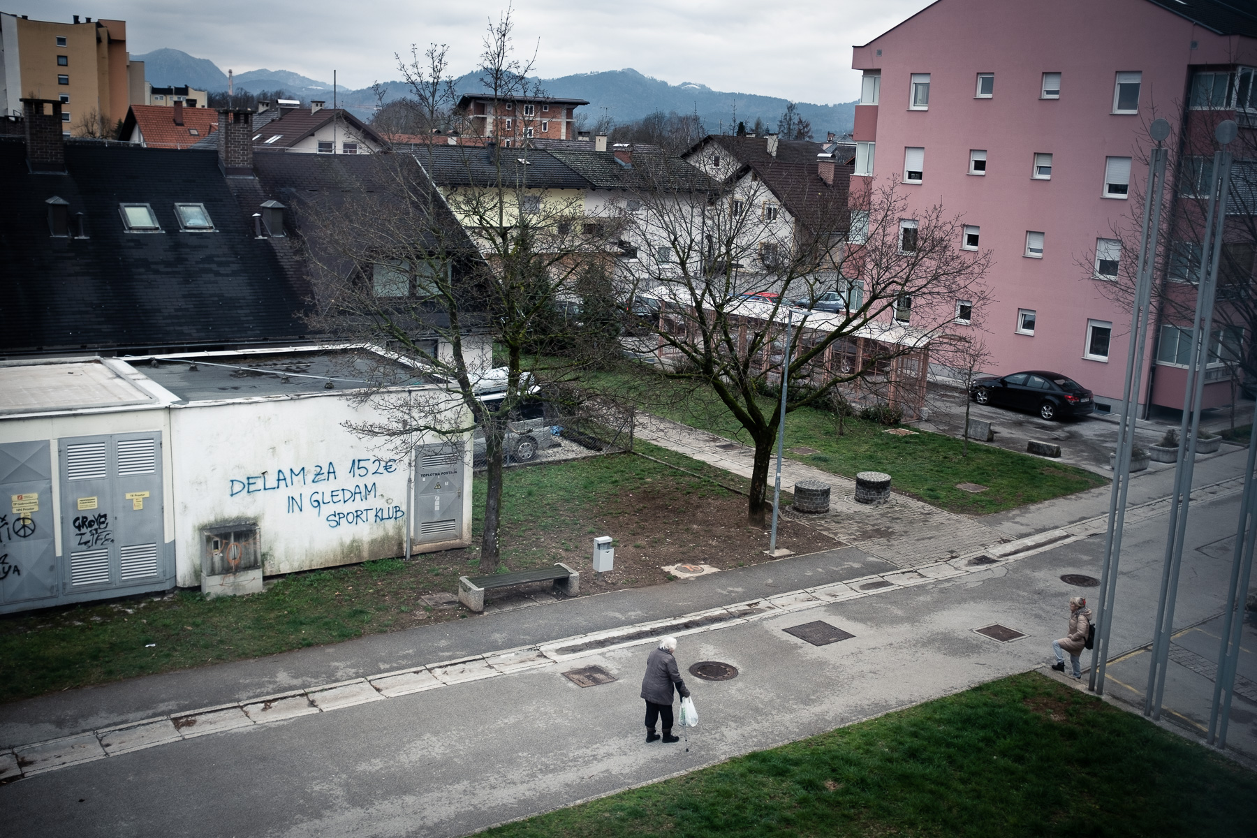 Two elderly women speak to each other on the street maintaining a large distance in accordance with social distancing rules during the coronavirus outbreak nationwide lockdown in Kranj, Slovenia, on March 22, 2020.