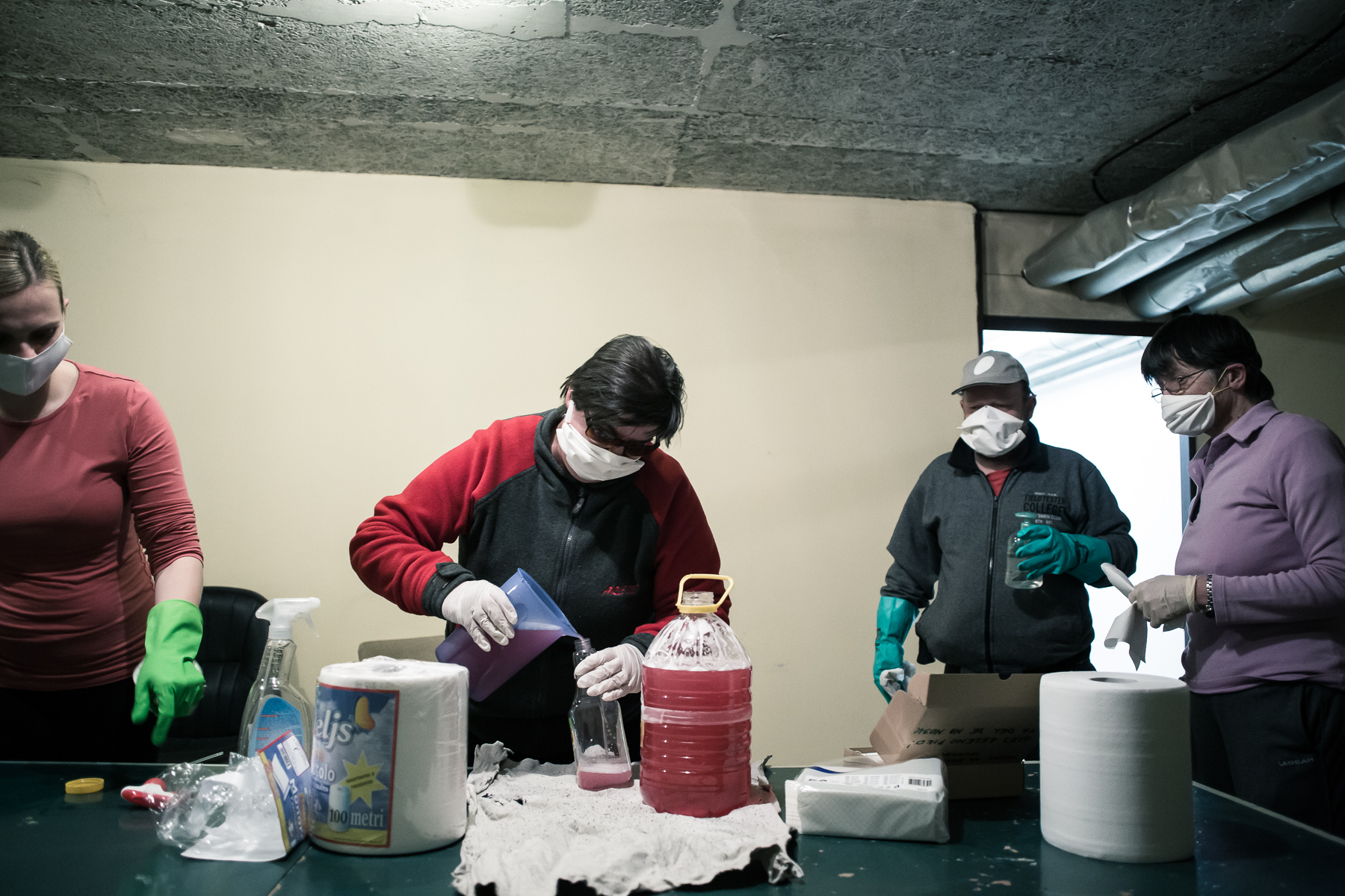 Residents of an apartment building in Kranj, Slovenia, prepare disinfectant solutions and materials during mandatory daily building disinfection on April 2, 2020.