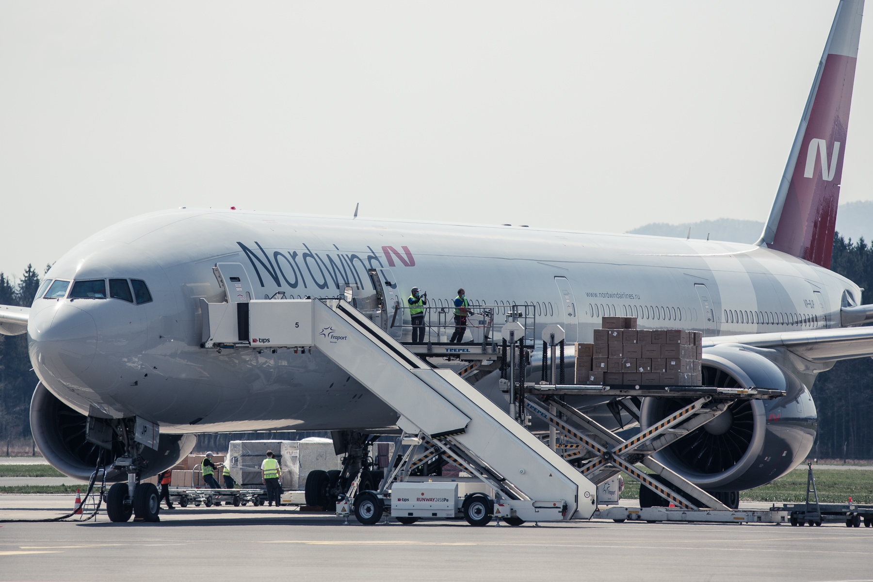A Nordwind Airlines Boeing 777 plane from China is unloaded with 40 tons of medical supplies at the Ljubljana Airport on April 11, 2020.