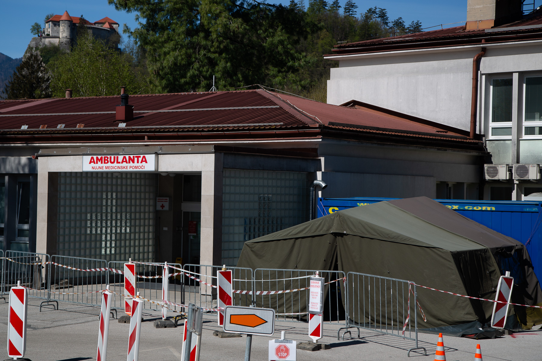 A COVID-19 testing site in front of a medical center in Bled, Slovenia, on April 16, 2020. The small town, known for its world famous tourist attraction, Lake Bled and the Bled Castle (seen in the background) is under strict lockdown and void of tourists after a month of nationwide quarantine.