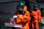 Medical personnel in hazmat suits handle coronavirus swab samples at the COVID-19 testing site in Bled, Slovenia, on April 16, 2020. In mid April the coronavirus epidemic in Slovenia began to wane, the country's daily numbers of newly infected dropped below thirty.