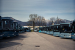 City buses are seen parked in a parking lot in Kranj, Slovenia, following a nationwide shut down of all public transport that was implemented on March 16, 2020, to stop the spread of the coronavirus.