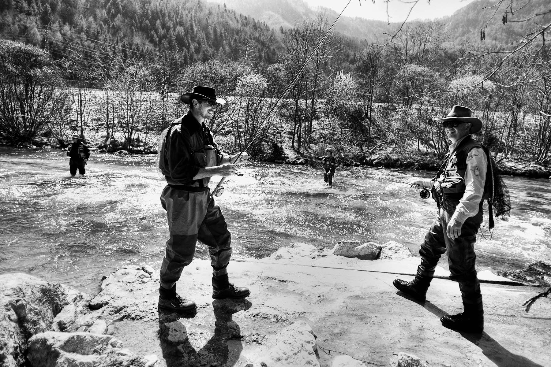 Fishermen change positions at the National Fly Fishing Championship competition in Jesenice, April 3, 2011.