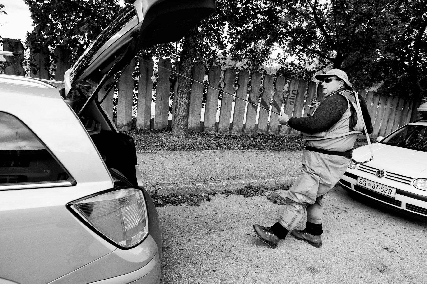 Dušan Dolinar takes the fishing rod out of his car as he arrives to his sector at the National Fly Fishing Championship competition in Mozirje, Slovenia, October 9, 2011.