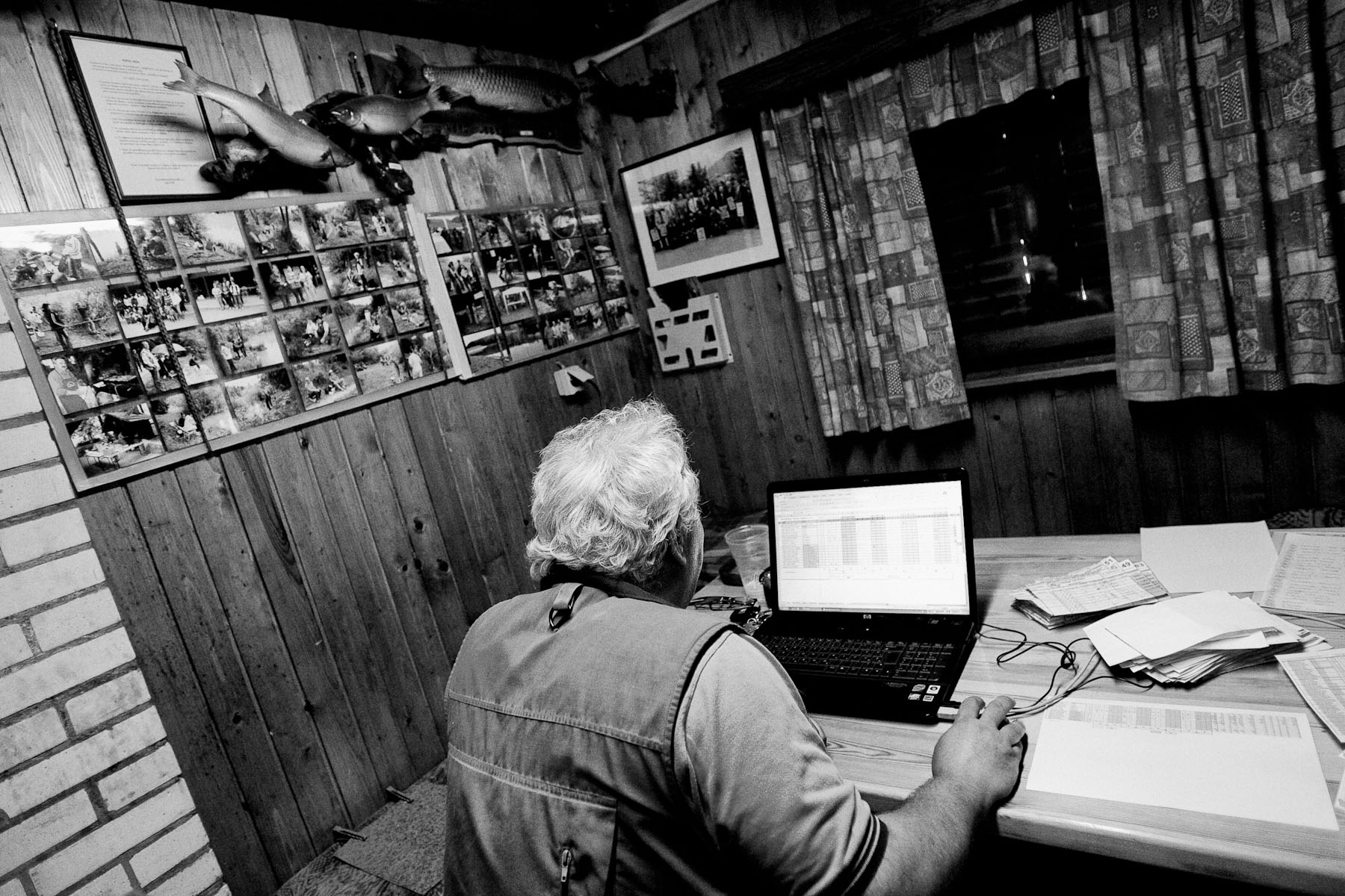 Saso Rebula calculates results in a fishing club cottage after the National Fly Fishing Championship competition in Kamnik, Slovenia, May 29, 2011.