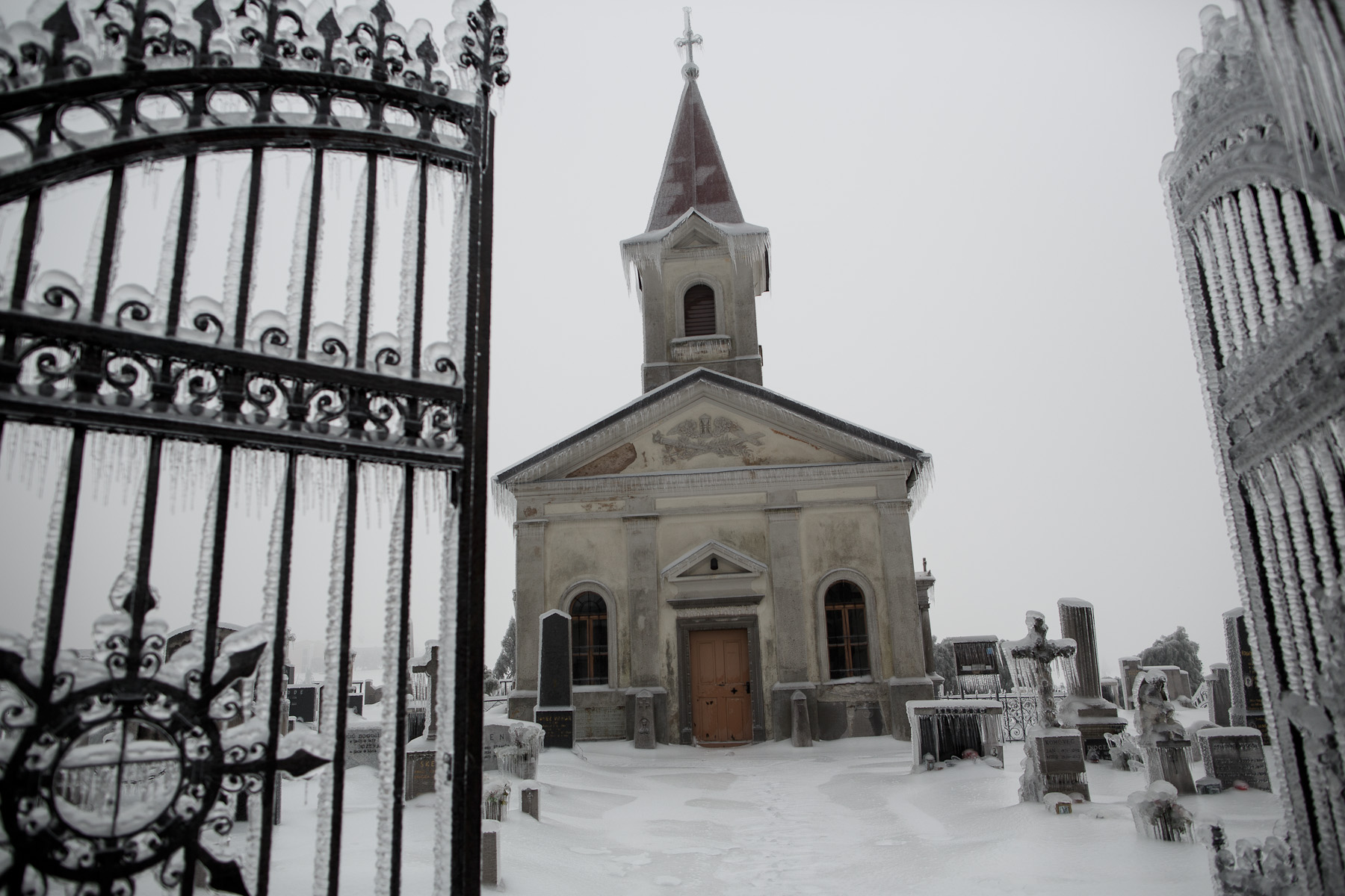 A church and a cemetery are engulfed in ice in Postojna, Slovenia, February 5 2014.