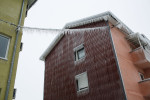 A facade of an apartment building is covered in more than 5 cm of ice in Postojna, Slovenia, February 5 2014.