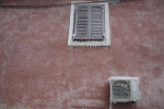 A frozen window and airconditioning device is seen on a building covered in ice in Postojna, Slovenia, February 5 2014.