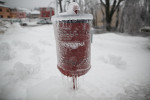 A frozen dustbin with the name of the town written on it is seen in Postojna, Slovenia, February 5 2014.