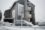 An apartment building, cars and signposts are seen covered in thick layer of ice in Postojna, Slovenia, February 5 2014.