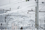 A soldier walks amon ice-covered power lines and broken constructions of the train station in Postojna, Slovenia, February 5 2014.