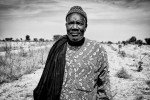 Mamadou Mambone stands on the land he has sold to the African National Oil Corporation near the village of Colobane after a woman from the region working for the company, persuaded him that the deal presents a positive development for his family and the village as a whole. Together with his brother, he sold more than 15 ha of land. Similar to others, they signed a blank paper, with which they allegedly sold the land. »A woman came and told me she is from the region, and that she has seen something good and wishes to bring this to our village; she promised that they will pay 20000 francs for 1 ha of land, but beside that the most important is employment they promised to provide us with« were the words of his brother, describing the way they were persuaded to sell their land to the company. Both, Mamadoue and his brother, have large families and regular income gained from employment would present much welcomed contribution to their families.