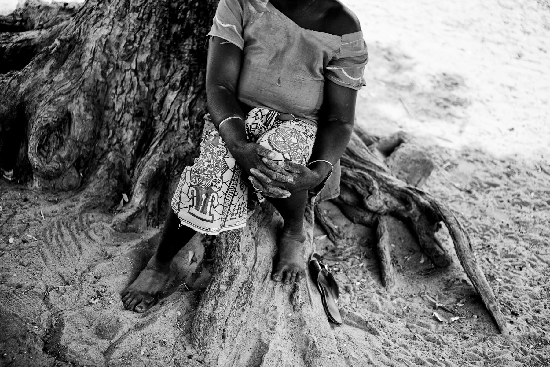 Ndaye Fall, who sold all the land to the African National Oil Corporation, sits under a tree outside her home in Kaloac, Senegal. After the death of her husband she sold all her land to the company, with a vision that she would more easily provide for her eight children if she gains additional income by being employed at the company. The company did not keep the promise. They offered her work for only two months in bad working conditions and without regular payment. Before selling her land, Ndaye was growing millet and peanuts. Now she has to buy the peanuts at the market, grilling them and selling them in order to survive. In case she would get her land back, she would not only be able to grow her own peanuts, but also lease some land to others in order to gain additional income for her and her family.